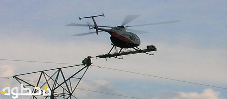 عمال خطوط الكهرباء